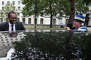 Pro remain campaigner Steve Bray interviews Kwasi Kwarteng MP, Minister of State at the Department of Business, Energy and Industrial Strategy, as he leaves the Cabinet office in London, United Kingdom on 16th August 2019.