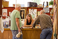 Doug Petelle of Northfield with Carol Center and Link Fournier at Laconia Antique Center on downtown Main Street.  (Karen Bobotas/for the Laconia Daily Sun)