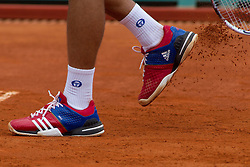 18.04.2012 Country Club, Monte Carlo, MON, ATP World Tour, Rolex Masters, 2. Runde, im Bild Novak Djokovic (SRB) clears clay off his training shoes during the second round match between Novak Djokovic (SRB) and Andreas Seppi (ITA) // at the Rolex Masters tennis tournament second Round of ATP World Tour at Country Club, Monte Carlo, Monaco on 2012/04/17. EXPA Pictures © 2012, PhotoCredit: EXPA/ Mitchell Gunn