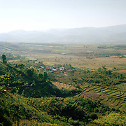 View of Ban Lao Khao Akha Pouli ethnic minority village and the plain of Muang Sing, Luang Namtha Province, Lao PDR