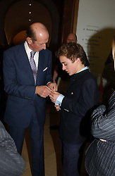 Left to right, HRH THE DUKE OF KENT and his grandson LORD DOWNPATRICK  at the Depal Trust 2in1 Art Party at The National Portrait Gallery, London on 25th October 2004.<br /><br /><br /><br />NON EXCLUSIVE - WORLD RIGHTS