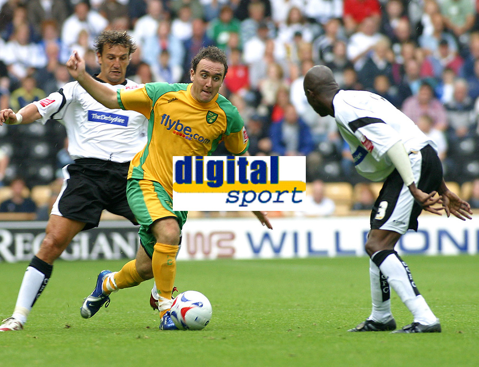 Photo: Dave Linney.<br />Derby County v Norwich City. Coca Cola Championship. 19/08/2006.Norwich's Lee Croft tries to find a way through the Derby defence