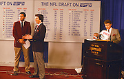 ESPN sports analyst Chris Berman looks on while ESPN sports analyst Mel Kiper talks and gestures during the 1987 NFL Draft on April 28, 1987 in New York. (©Paul Anthony Spinelli)