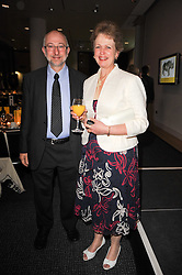 Photogrpher STEVE BLOOM and his wife KATHY at a dinner in aid of Save The Rhino held at The Battlebridge Room, Kings Place, London N1 on 20th October 2010.