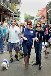 31 January 2016. New Orleans, Louisiana.<br /> Mardi Gras Dog Parade. Lisa, her mum, Brian and Wheezy. The Mystic Krewe of Barkus winds its way around the French Quarter with dogs and their owners dressed up for this year's theme, 'From the Doghouse to the Whitehouse.' <br /> Photo©; Charlie Varley/varleypix.com