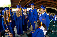 Salutatorian Mary Snow (left) surrounded by her fellow graduates prior to the 2012 Gilford High School Commencement at Meadowbrook Pavilion Saturday morning.  (Karen Bobotas/for the Laconia Daily Sun)