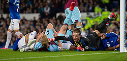 LIVERPOOL, ENGLAND - Monday, September 13, 2021: Everton's goalkeeper Jordan Pickford clashes with Burnley's captain Ben Mee during the FA Premier League match between Everton FC and Burnley FC at Goodison Park. (Pic by David Rawcliffe/Propaganda)