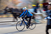 Male cyclist bike riding in winter time in Central Park, New York, USA
