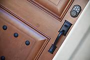 Wood Front Door with Satin Black Hardware Stock Photo