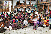 The audience watching the performances at he Black-necked Crane Festival at Gangte Goemba, Phobjikha Valley, Bhutan. Every year on November 11th, the local community hosts the festival at Gangte Goemba, to highlight the cranes significance to the valley. Phobjikha Valley is the most significant overwintering ground of the rare and endangered Black-necked Crane in Bhutan.