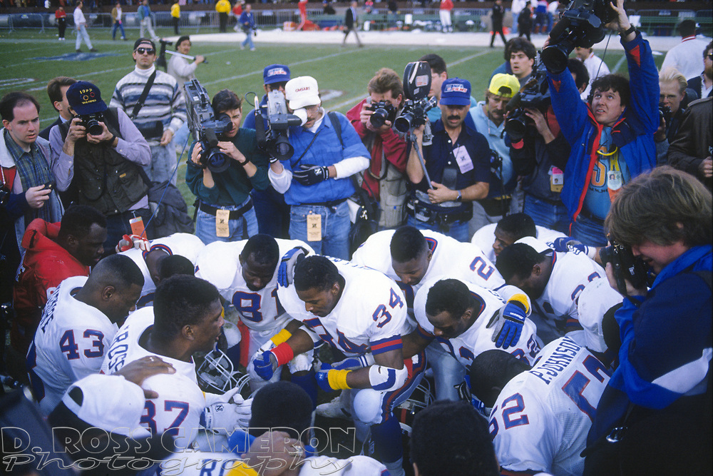 Players from the New York Giants and San Francisco 49ers kneel in prayer at the center of the field following their NFC Championship NFL football game, Sunday, Jan. 20, 1991 at Candlestick Park in San Francisco. The Giants won, 15-13, and advance to the Super Bowl. (D. Ross Cameron/Tri-Valley Herald)