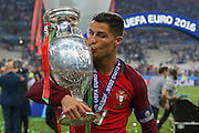 Portugal Forward Cristiano Ronaldo kisses the trophy during the Euro 2016 final between Portugal and France at Stade de France, Saint-Denis, Paris, France on 10 July 2016. Photo by Phil Duncan.