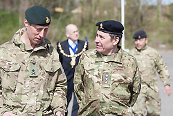 © London News Pictures. 18/04/2013. Jools Holland appointed 101 Engineer Regiment Honorary Colonel talks to Major General  T B Radford DSO OBE on the parade ground at Invicta Park Barracks, Maidstone Kent. Around 300 members of the Operation Herrick 17 Explosive Ordnance Disposal and Search Task Force receive the Afghanistan Campaign Medal at a ceremony in Maidstone.today 18/04/13.  The ceremony took place at Invicta Park barracks, home to 36 Engineers Regiment (Search), which was the lead element in the task force.  Picture credit should read Manu Palomeque/LNP