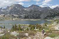 Fremont Peak, Wyoming's third-largest mountain, looms over Island Lake in the Wind River Mountains. The trail to the lake is a moderate but long 12-mile hike.