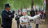 A royal enthusiast  talks to a policeman at the junction of the Mall and  Horse Guards Road for the Royal Wedding in London Friday, April, 29, 2011. (AP Photo/Bogdan Maran)