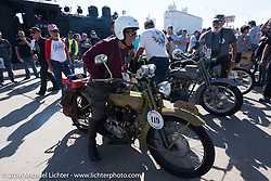 Birtrand Miskell puts his bike on display at the finish line in Dodge City, KS during the Motorcycle Cannonball Race of the Century. Stage-8 from Wichita, KS to Dodge City, KS. USA. Saturday September 17, 2016. Photography ©2016 Michael Lichter.