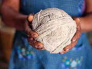 Juana Gutierrez Contreras holding a ball of hand spun churro sheep wool  in the natural dyes studio in the Zapotec village of Teotitlan del Valle, Oaxaca, Mexico on 25 November 2018. The handspun yarn comes from the nearby mountain village of Chichicapam