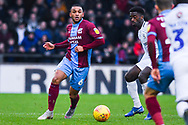 Funso Ojo of Scunthorpe United (6) passes the ball during the EFL Sky Bet League 1 match between Scunthorpe United and Coventry City at Glanford Park, Scunthorpe, England on 5 January 2019.