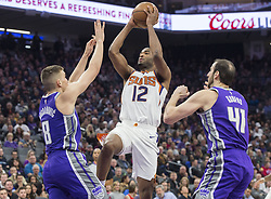 December 29, 2017 - Sacramento, CA, USA - The Phoenix Suns' TJ Warren (12) drives to the basket against the Sacramento Kings' Bogdan Bogdanovic (8) on Friday, Dec. 29, 2017, at the Golden 1 Center in Sacramento, Calif. (Credit Image: © Hector Amezcua/TNS via ZUMA Wire)