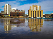 29 MARCH 2019 - ST. PAUL, MN: The Mississippi River, past flood stage, flows past downtown St. Paul. The Mississippi River through the Twin Cities has already hit flood stage. Several roads and parks in St Paul are already closed in anticipation of higher flood levels. Weather forecasters and hydrologists have backed off a little on earlier predictions of severe flooding because the snow melt has been slower than expected.     PHOTO BY JACK KURTZ