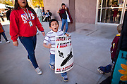 07 FEBRUARY 2011 - PHOENIX, AZ:  KEVIN OLIVER, 8, marches at the Arizona Capitol in support of birthright citizenship and the 14th Amendment Monday, February 7. The Arizona State Legislature, led by the State Senate is debating the 14th Amendment, which would bar US citizenship for the children of undocumented immigrants born in the United States. The bill has broad support among Republicans, who are the majority party, in the state legislature but not among Democrats. The law is also very unpopular in the state's Latino and immigrant communities.       Photo by Jack Kurtz