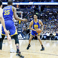 13 February 2017: Golden State Warriors guard Patrick McCaw (0) passes the ball to Golden State Warriors forward Kevin Durant (35) during the Denver Nuggets 132-110 victory over the Golden State Warriors, at the Pepsi Center, Denver, Colorado, USA.
