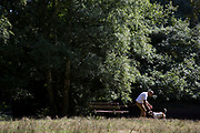 "Man and his dog. Hampstead Heath (locally known as ""the Heath"") is a large, ancient London park, covering 320 hectares (790 acres). This grassy public space is one of the highest points in London, running from Hampstead to Highgate. The Heath is rambling and hilly, embracing ponds, recent and ancient woodlands."