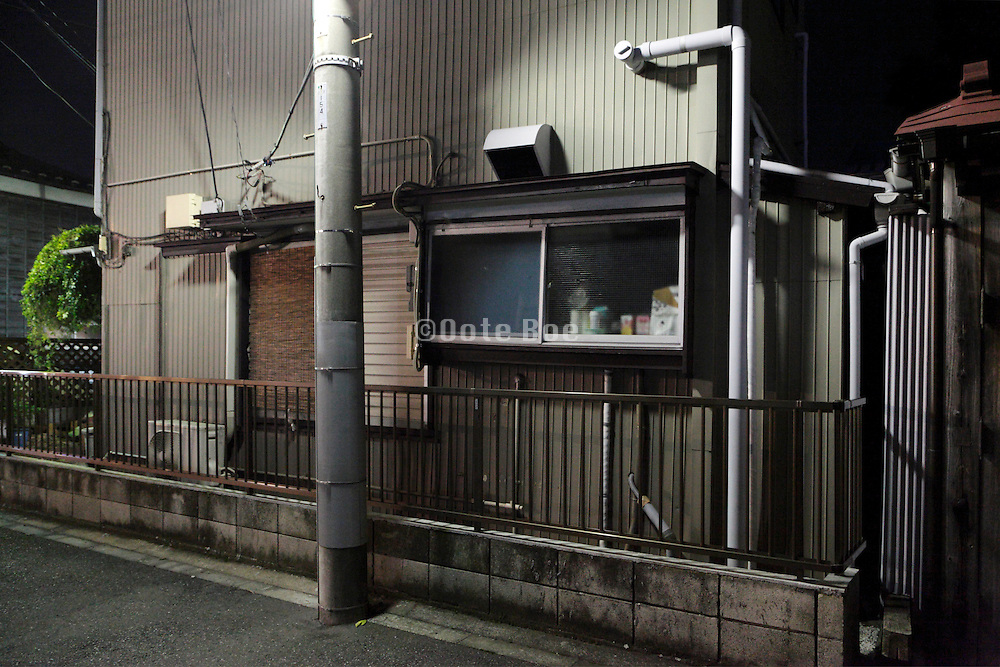 old residential house illuminated by street light Japan