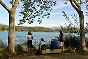 Banyoles, SPAIN,   Coaches watch from the shaded area of the bank as their crews train at the FISA World Cup Rd 1. Lake Banyoles  Thursday 28/05/2009   [Mandatory Credit. Peter Spurrier/Intersport Images]