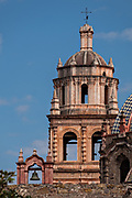 The bell tower of the San Francisco Convent and the Aranzazu Chapel in the Plaza de Aranzazu in the state capital of San Luis Potosi, Mexico. The chapel and convent was built between 1749 and 1760 and features Churrigueresque details and tiled domes.