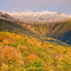 A snow-capped Mount Lafayette in fall in New Hampshire's White Mountains. White Mountain National Forest.
