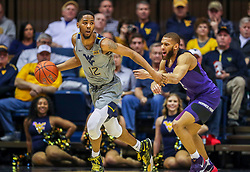 Jan 14, 2020; Morgantown, West Virginia, USA; West Virginia Mountaineers guard Taz Sherman (12) dribbles out while guarded by TCU Horned Frogs guard Edric Dennis (2) during the first half at WVU Coliseum. Mandatory Credit: Ben Queen-USA TODAY Sports