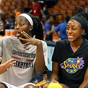 Sisters Chiney Ogwumike, (left), Connecticut Sun and Nneka Ogwumike, Los Angeles Sparks during a media interview before playing against each other for the fist time in the WNBA during the Connecticut Sun Vs Los Angeles Sparks WNBA regular season game at Mohegan Sun Arena, Uncasville, Connecticut, USA. 3rd July 2014. Photo Tim Clayton