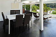 Architecture, open space of a modern house, <br /> dining table with chairs