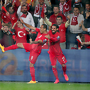 Turkey's Umut Bulut (L) celebrate his goal with team mate during their UEFA Euro 2016 qualification Group A soccer match Turkey betwen Czech Republic at Sukru Saracoglu stadium in Istanbul October 10, 2014. Photo by Aykut AKICI/TURKPIX