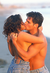 Couple without shirts on kissing