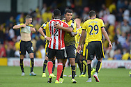 Troy Deeney, the Watford captain and Victor Wanyama of Southampton hugging after the final whistle. Barclays Premier League, Watford v Southampton at Vicarage Road in London on Sunday 23rd August 2015.<br /> pic by John Patrick Fletcher, Andrew Orchard sports photography.