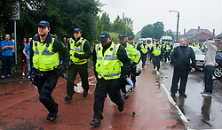PSU officers are brought up to contain EDL supporters during a rally in  Hexthorpe Doncaster South Yorkshire on Saturday. The EDL and UAF are thought to have chosen Hexthorpe after recent media reports of tension between newly arrived Roma residents and the the local community<br /> 19 July 2014<br /> Image © Paul David Drabble <br /> www.pauldaviddrabble.co.uk