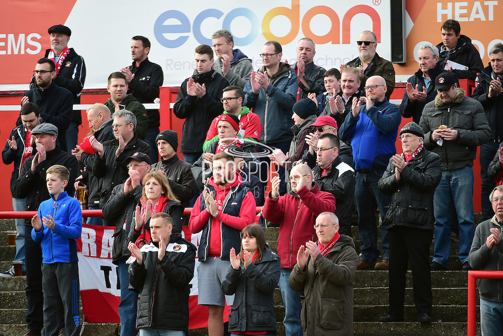 Ebbsfleet fans applaud in the memory of Paul McCarthy during the Vanarama National League South match between Ebbsfleet United and East Thurrock United at the Enclosed Ground, Whitehawk, United Kingdom on 4 March 2017. Photo by Jon Bromley.