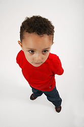 Wide angled shot of young boy standing,