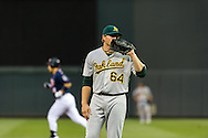 Oakland Athletics pitcher A.J. Griffin reacts after giving up a home run to Minnesota Twins left fielder Josh Willingham (background) on July 13, 2012 at Target Field in Minneapolis, Minnesota.  The Athletics defeated the Twins 6 to 3.  © 2012 Ben Krause