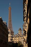 A Parisian street and the Eiffel Tower, Paris, France