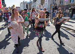 """© Licensed to London News Pictures;17/04/2021; Bristol, UK. Kill the Bill protesters march through the city centre during a ninth """"Kill the Bill"""" protest taking place in Bristol against the Police, Crime, Sentencing and Courts Bill during the Covid-19 coronavirus pandemic in England. The protest is taking place on the same day as the funeral of Prince Philip the Duke of Edinburgh. The Police, Crime, Sentencing and Courts Bill proposes new restrictions on protests. Some previous Kill the Bill protests in Bristol had violence. Photo credit: Simon Chapman/LNP."""
