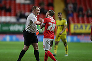 Chris Solly of Charlton Athletic pleads  to try to prevent Referee Trevor Kettle from giving a red card to Tareiq Holmes-Dennis of Charlton Athletic for fouling Ben Osborn of Nottingham Forest . Skybet football league championship match, Charlton Athletic v Nottingham Forest at The Valley  in London on Saturday 2nd January 2016.<br /> pic by John Patrick Fletcher, Andrew Orchard sports photography.