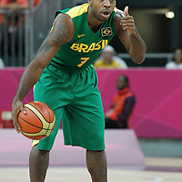 31 July 2012: Brazil Larry Taylor sets the offense during 67-62 Team Brazil victory over Team Great Britain, during the men's basketball preliminary, at the Basketball Arena, in London, Great Britain.