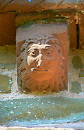 Norman Romanesque exterior corbel no 14 - sculpture of head, half man half lion. The Norman Romanesque Church of St Mary and St David, Kilpeck Herefordshire, England. Built around 1140 .<br /> <br /> Visit our MEDIEVAL PHOTO COLLECTIONS for more   photos  to download or buy as prints https://funkystock.photoshelter.com/gallery-collection/Medieval-Middle-Ages-Historic-Places-Arcaeological-Sites-Pictures-Images-of/C0000B5ZA54_WD0s