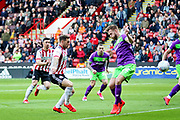 Sheffield Utd forward Billy Sharp (10) with a shot during the EFL Sky Bet Championship match between Sheffield United and Bristol City at Bramall Lane, Sheffield, England on 30 March 2019.