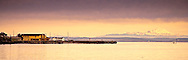 Morning alpenglo lights Mt Baker across Admiralty Bay as seen from Port Townsend on the Olympic Peninsula, WA, USA.