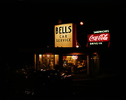 "Ackroyd C00098-1. ""Bells Car Service. Exterior."" (March 7, 1950. Night view of drive-in restaurant. 633 SE Powell. Now the Lucky Devil strip club. See also black & white #2064-3)"