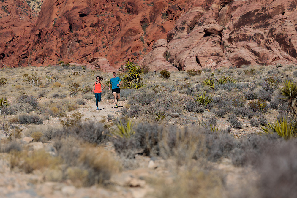 Matt and Emily Setlack trail running the Calico Hills Trail